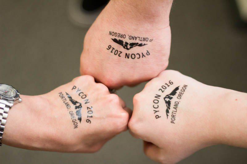 Caktus staff show off their PyCon 2016 temporary tattoos.