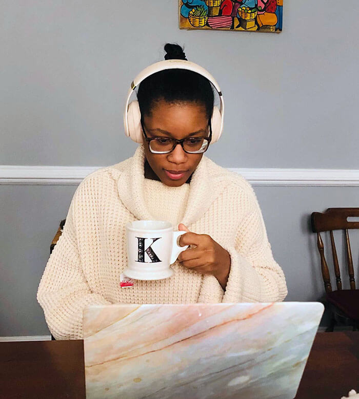 Kel Hanna listens to music while working