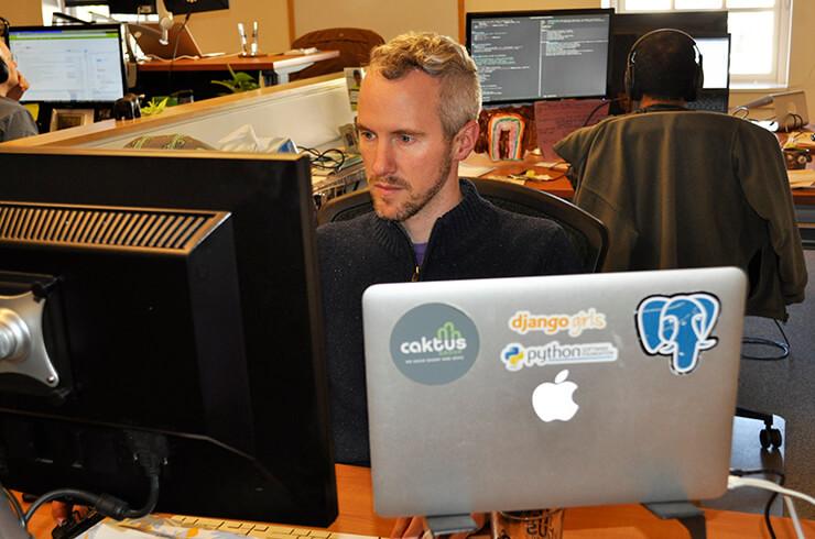Caktus CEO Tobias McNulty working at his desk