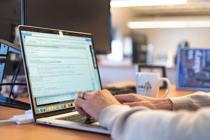 A Caktus developer working on a laptop