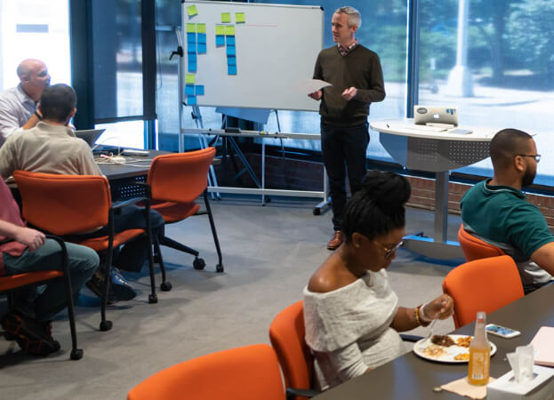 Caktus team listens to presenter
