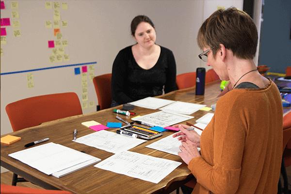 UX designers working at desk