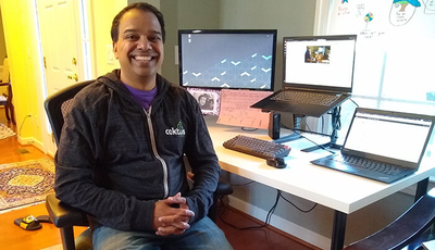 Developer and blog author Vinod Kurup working at his desk at home