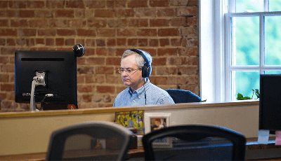 Developer Dan Poirier at work on his computer.