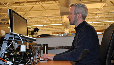 CEO Tobias McNulty is programming at his desk.